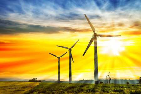 renewable energy resources: Eco power in wind turbine farm with sunset.