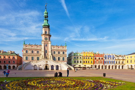 main market: People visitors Main Market square in the Old Town, on April 02, 2016 in Zamosc, Poland.