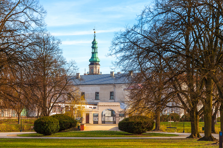 main gate: City park on a background of famous old Main Gate Park in Zamosc, Poland.