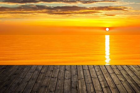 jetty: Sunset background with empty plank and sea. Stock Photo