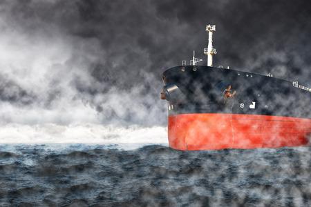 Cargo ship at sea during a storm. Stock Photo