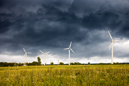 wind storm: Dark clouds above a Wind Turbines.