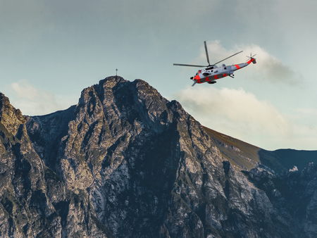 danger accident: Helicopter on a rescue mission in the Tatras Mountains.