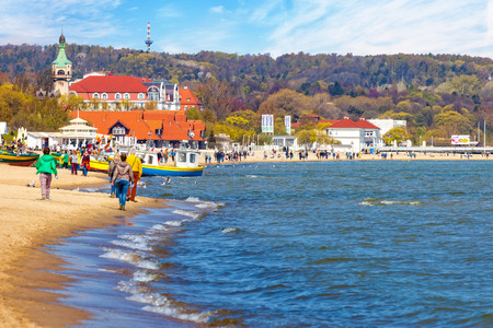 baltic people: Baltic coast beach scene of many people walking along the coast, on May 03, 2016 in Sopot, Poland. Editorial