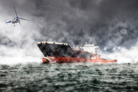difficult mission: A helicopter rescue mission in difficult stormy weather. Stock Photo
