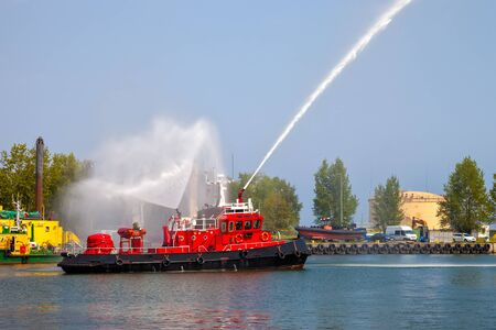 rescue: Fire fighting boat sprays water in port.