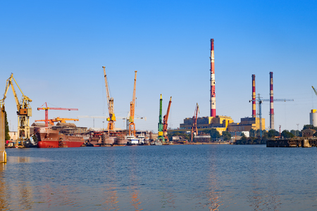 drydock: View wharf shipyard with high chimneys in the background in Gdansk, Poland. Stock Photo