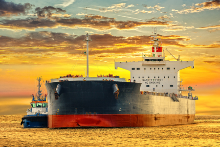 tanker ship: Tanker ship on sea in the rays of the setting sun.