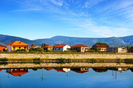neretva: Rows of houses along the Neretva river.