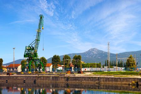 neretva: Small crane on the edge of the Neretva river in Metkovic, Croatia. Stock Photo