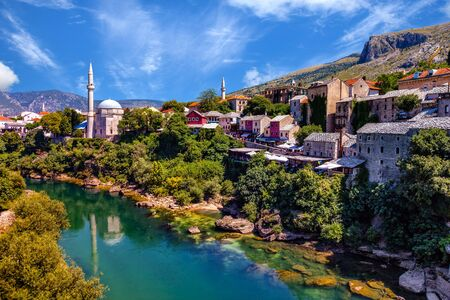 neretva: View at the Old Town in Mostar with emerald river Neretva. Bosnia and Herzegovina.