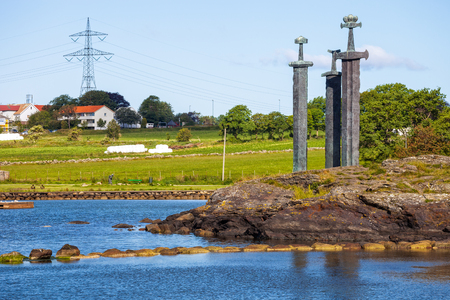architecture monumental: Three large swords stand on the hill as a memory to the Battle of Hafrsfjord in year 872 in Stavanger, Norway.