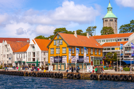 People at the quay port with many restaurants and pubs in the city centre of Stavanger, Norway. Editorial