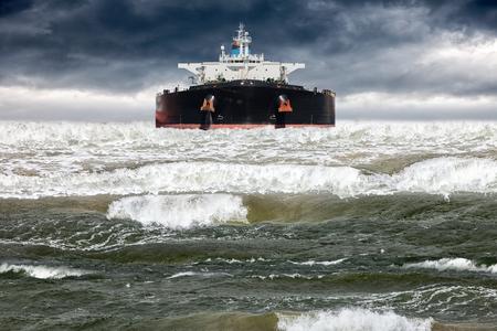 storm tide: Big ship at sea during a storm. Stock Photo