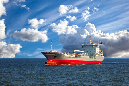 marine industry: Oil tanker ship at sea on a background of blue sky.