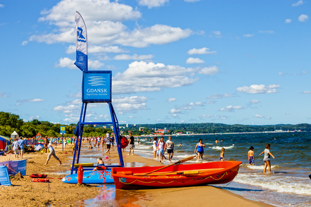 suntanning: Sandy beach scene of many people suntanning, relaxing and enjoying the shore, on August 15, 2016 in Sopot, Poland.