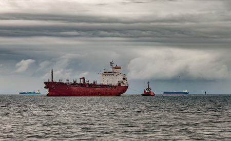 storms: Ship at sea against a dramatic sky.