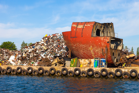 Dismantling the ship on scrap metal ready for recycling. Stock Photo