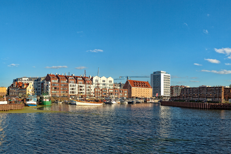 apartment tower old town: A view of the boats moored popular marina in Gdansk, Poland.
