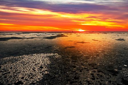 sea scenery: Sunset on a sea in winter scenery.