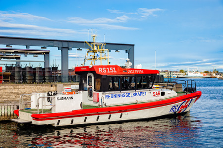 STAVANGER, NORWAY - OCTOBER 10, 2016: SAR - search and rescue boat in the harbor. The Sea Rescue Society maintains 30 boats stationed along the Norwegian coast.