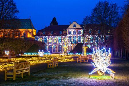 Christmas illumination at night in Oliwa Park, Poland. Stock Photo
