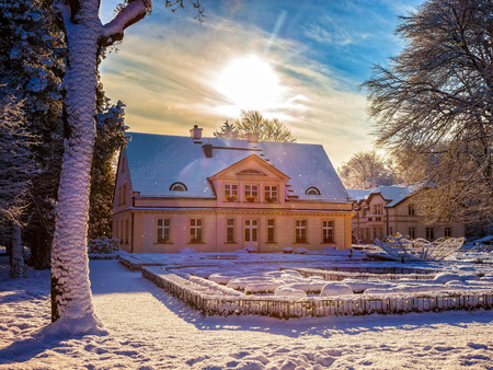 Snow covered city park in Oliwa, Poland. Stock Photo