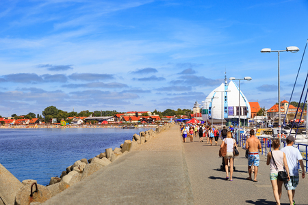 cruise travel: HEL, POLAND - AUGUST 10, 2015: People walking through in the port on the waterfront with many boat and sailboat in Hel. Hel is one of most famous cruise travel destinations in Poland. Editorial