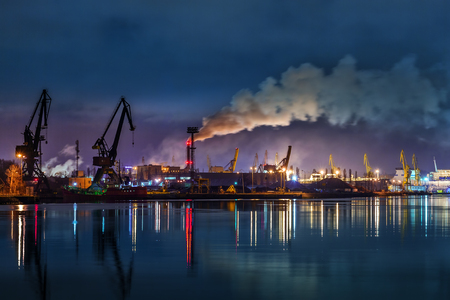 lading: Industry area - Port of Gdansk at night, Poland. Stock Photo