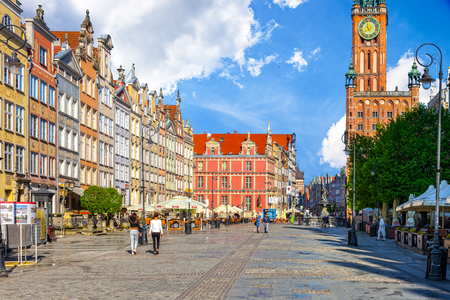 GDANSK, POLAND - MAY 19, 2017: Peoples on Long Street one of Europe's most beautiful town with renaissance building of the former Town Hall in Gdansk. Old Town in Gdansk is a tourist attraction for visitors.