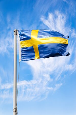 The Sweden national flag flying in the wind.
