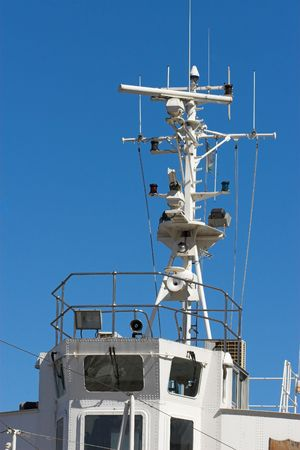 Ships bridge with mast and communication systems photo