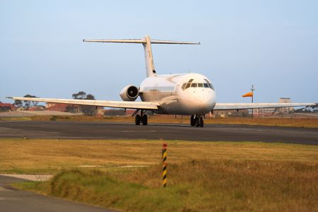 aluminum airplane: A passenger jetliner on the runway before take off Stock Photo