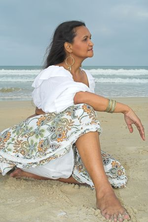 An American Indian woan relaxing at the beach photo