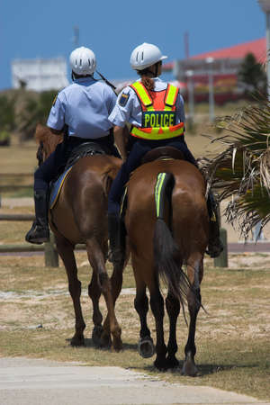 patrolling: Local Police on horse back patrolling the beach Stock Photo