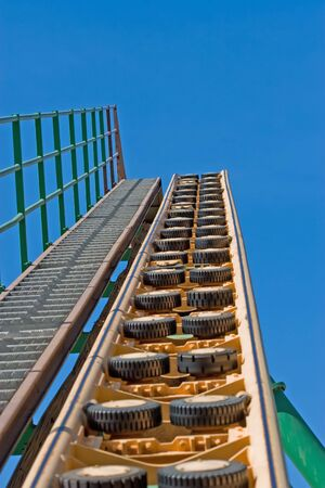Rollercoaster track against a brilliant blue sky photo