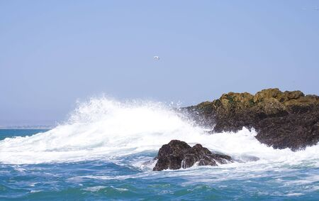deepsea: Powerful wave crashing up against the rocks in the middle of the ocean Stock Photo