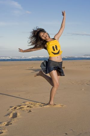 extrovert: Girl with Smiley Face Top, running at the beach