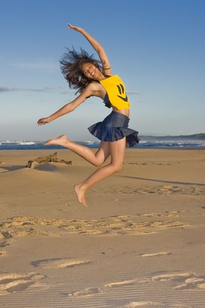 extrovert: Girl with smily face top on jumping in the air