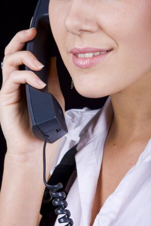 Close up of an attractive face answering the phone photo