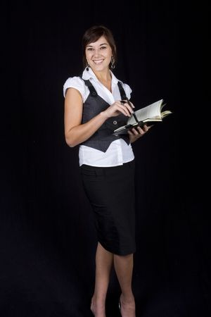 Sophisticated business lady with pen and diary photo