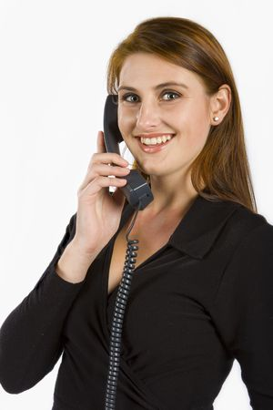 Attractive lady talking on a phone against a white background