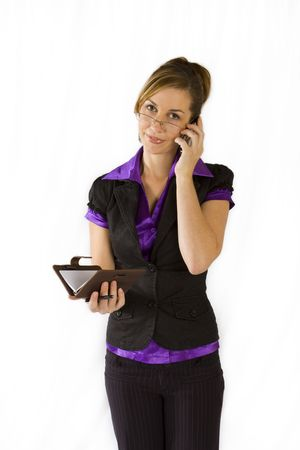 organiser: Business woman talking on cellular phone and organiser in hand