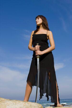 samurai sword: Attractive female model holding a samurai sword