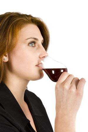 ingestion: Beautiful young woman drinking red wine isolated Stock Photo