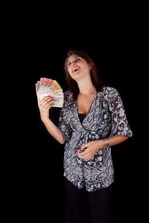 Young Lady fanning herself with various currency notes photo