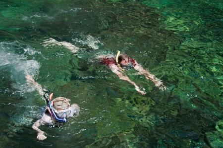 father&son are seeing the underworld ,andaman sea,krabi, thailand