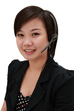 pretty young asian girl is giving information by telephone (portrait-isolated)