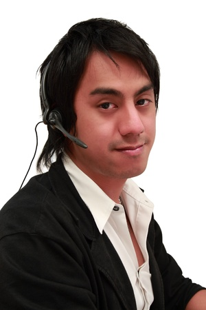 handsome young asian man is operate with telephone (portrait-isolated) photo
