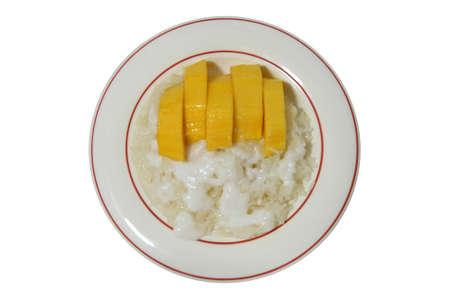 (summer thai dessert) mango and sticky rice mix with coconut milk Stock Photo